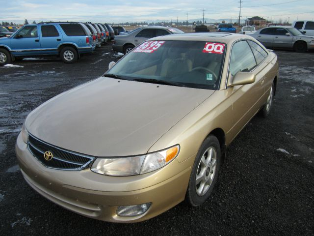2000 TOYOTA CAMRY SOLARA SLE gold we take trade-ins of all shapes and sizes paid for or not we f