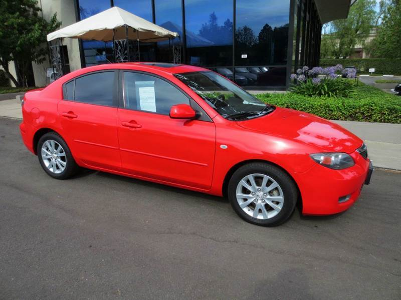 2007 MAZDA MAZDA3 I SPORT 4DR SEDAN 2L I4 4A red equipped with  power windows and door locks