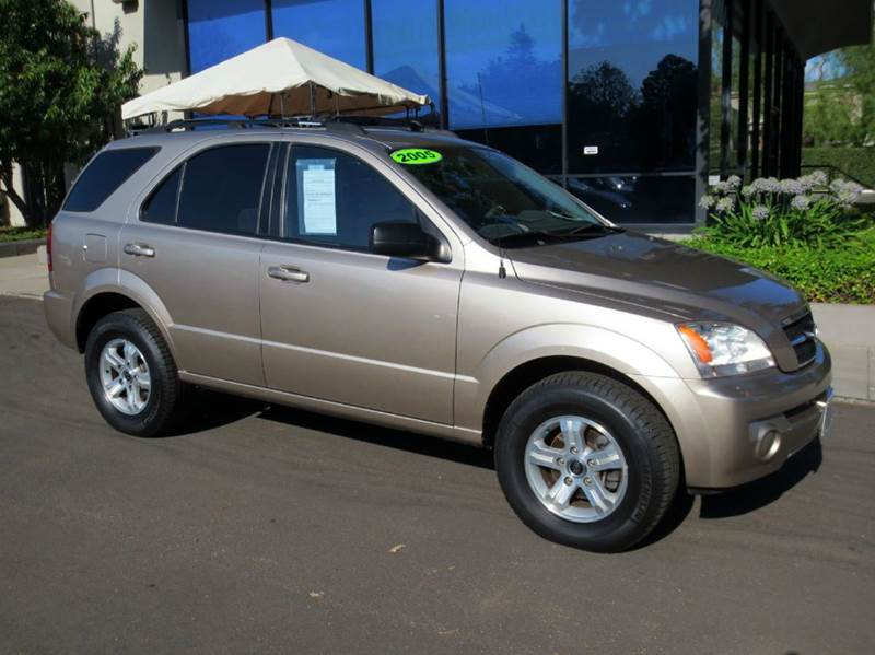 2005 KIA SORENTO LX 4DR SUV gold equipped with  power windows and door locks  tilt wheel  c