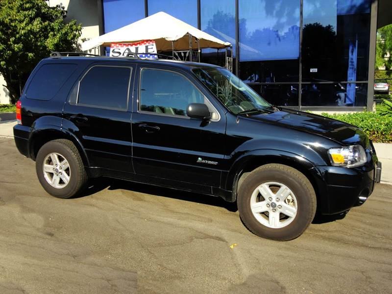 2006 FORD ESCAPE HYBRID BASE AWD 4DR SUV black  1 owner like new  4wd hybrid navigation le
