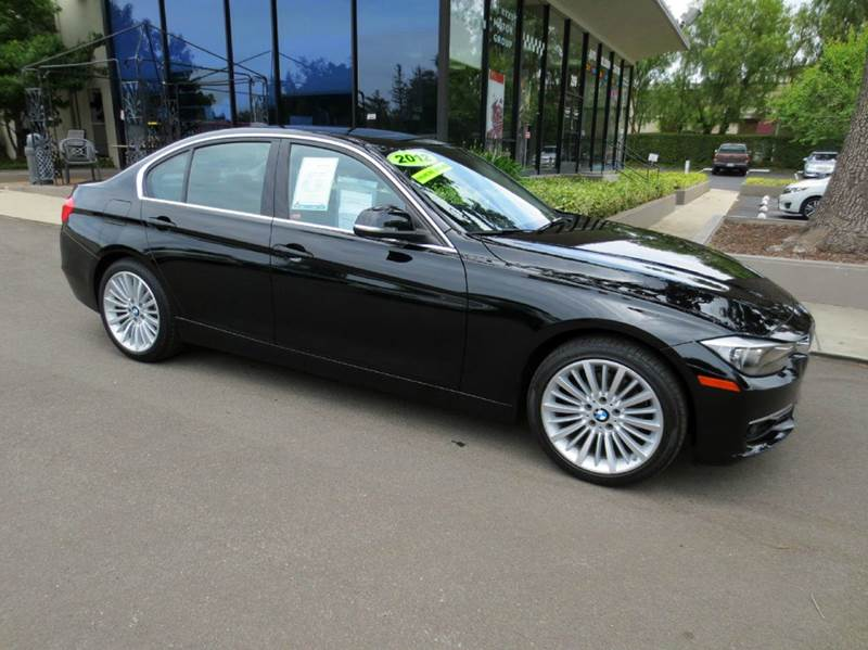 2012 BMW 3 SERIES 328I 4DR SEDAN jet black well equipped luxury line with technology pkg navigat