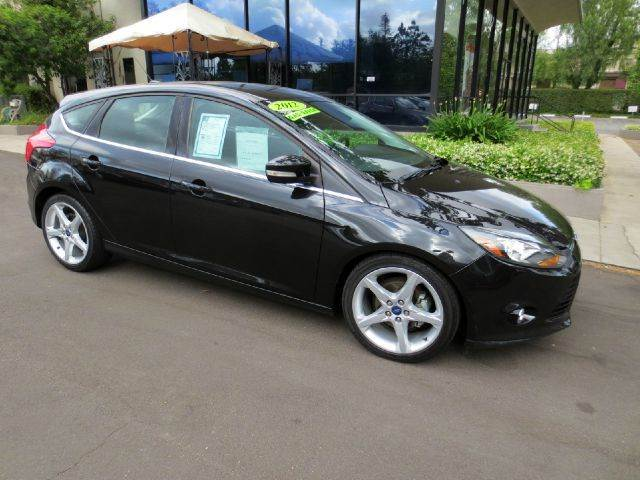 2012 FORD FOCUS TITANIUM 4DR HATCHBACK black metallic equipped with  sony premium sound  navig
