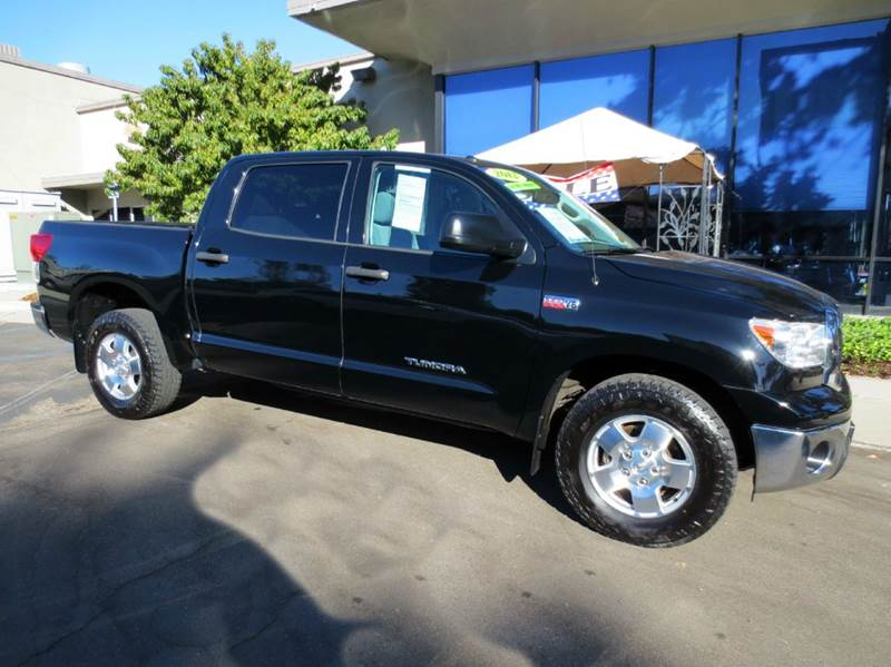 2012 TOYOTA TUNDRA 4X2 4DR CREWMAX CAB PICKUP SB 5 black sharp crewmax 57 l with tow pkg slidi