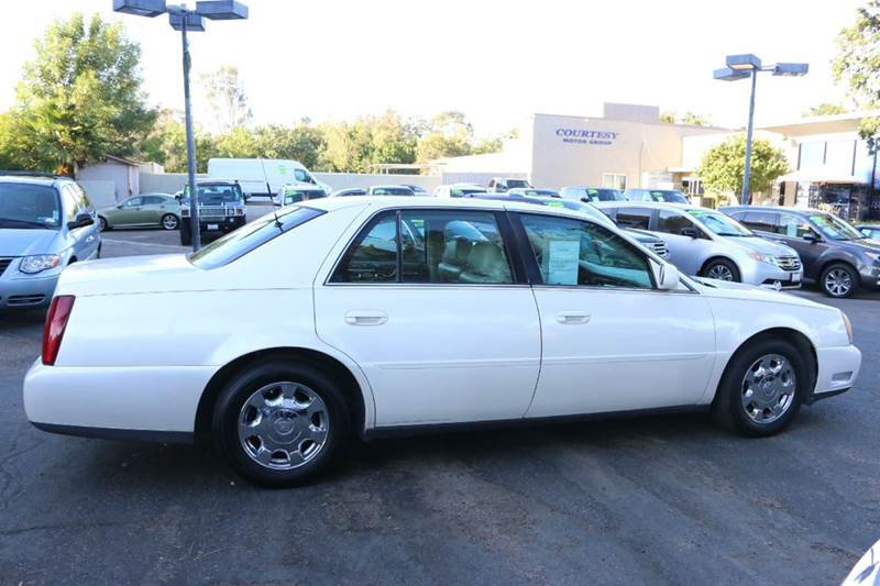 2002 CADILLAC DEVILLE BASE 4DR SEDAN diamond white elegantly equipped with leather moon roof and