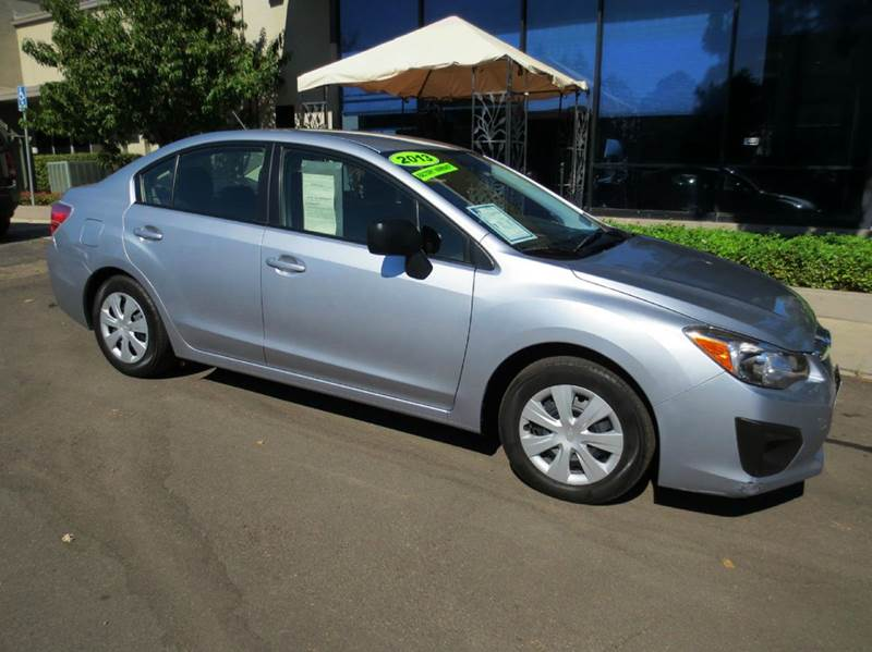 2013 SUBARU IMPREZA 20I AWD 4DR SEDAN 5M silver factory equipped with  power windows and door l