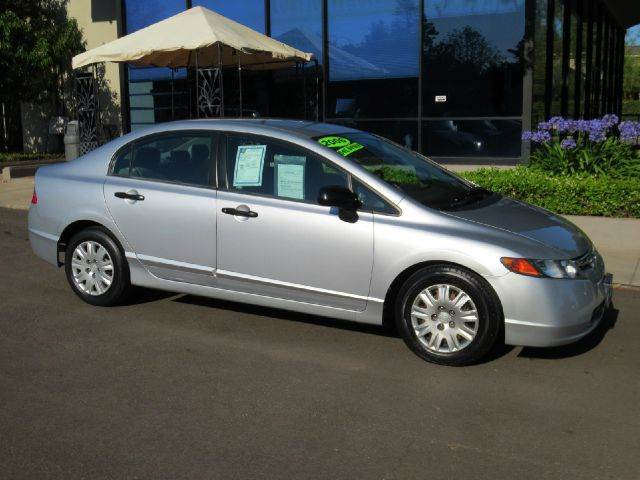 2006 HONDA CIVIC DX 4DR SEDAN silver equipped with  power windows  mp3 single disc  fuel-ef