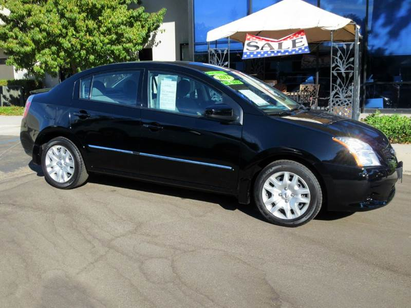 2012 NISSAN SENTRA 20 4DR SEDAN CVT black nicely equipped with power group rear spoiler ipod c