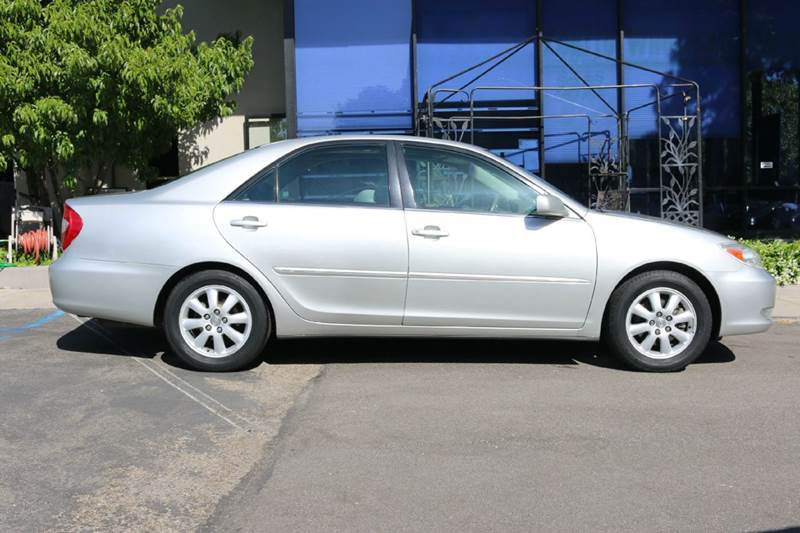 2003 TOYOTA CAMRY XLE V6 4DR SEDAN silver  nicely equipped with navigation leather moon roof