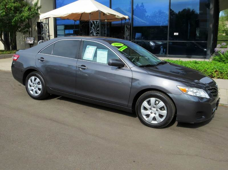 2010 TOYOTA CAMRY LE 4DR SEDAN 6A charcoal factory equipped with  power windows and door locks