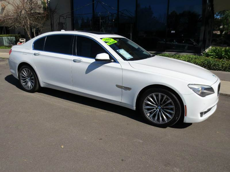 2011 BMW 7 SERIES 740LI 4DR SEDAN alpine white elegantly equipped with navigation convenience pkg