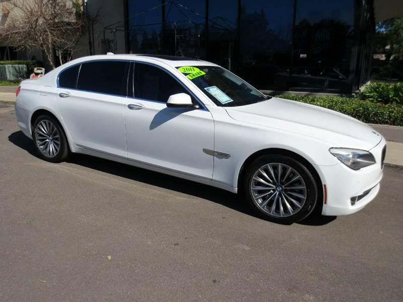 2011 BMW 7 SERIES 740LI 4DR SEDAN alpine white elegantly equipped with navigation convenience pkg