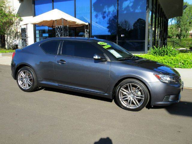 2011 SCION TC 2DR COUPE 6M charcoal nicely equipped with  panorama roof  premium sound  all