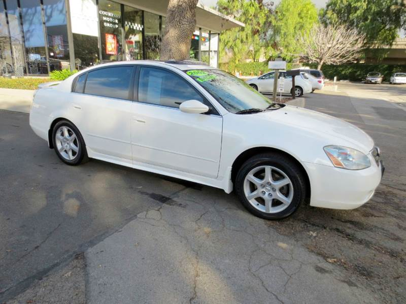 2002 NISSAN ALTIMA 35 SE 4DR SEDAN white must see one owner  low mileage full power moon roo