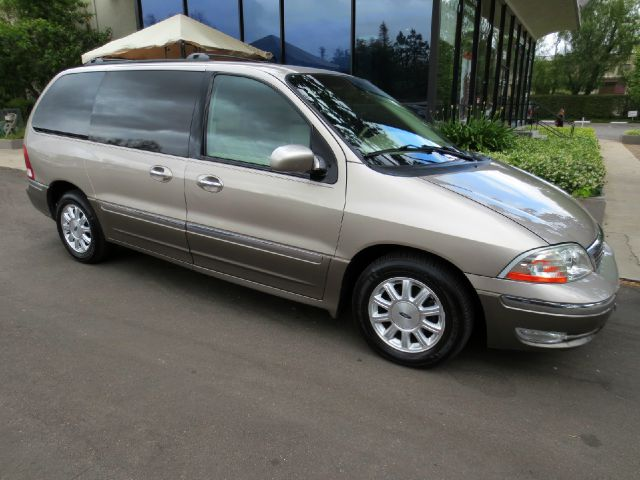 2003 FORD WINDSTAR LIMITED 4DR MINIVAN champagne equipped with  leather  dual power seats