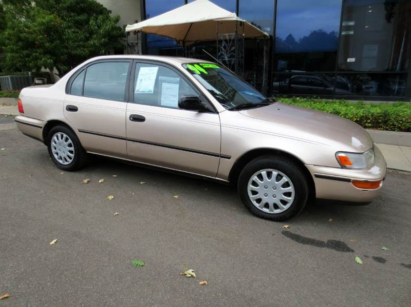 1994 TOYOTA COROLLA DX 4DR SEDAN champagne extra clean  low miles carfax one owner no accidents