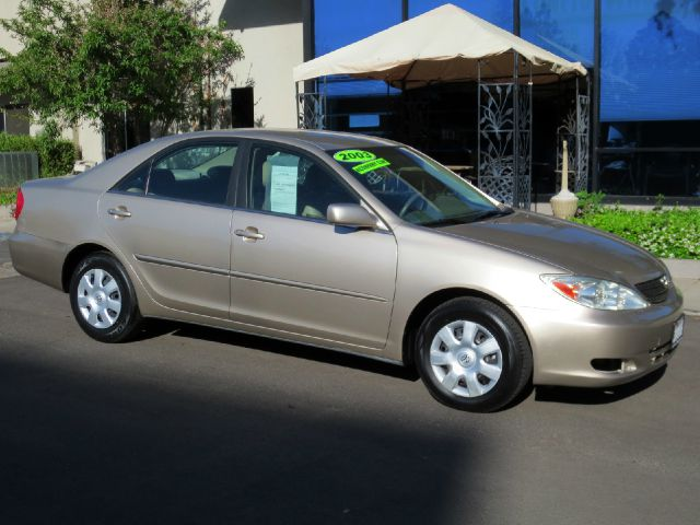 2003 TOYOTA CAMRY LE 4DR SEDAN champagne equipped with  power windows and door locks  tilt wh
