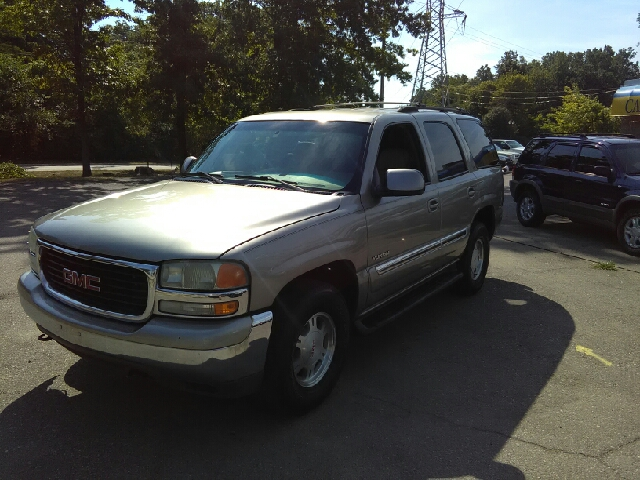 2002 GMC YUKON SLE 2WD 4DR SUV gold meteoric acceleration spins like a top when was the last ti