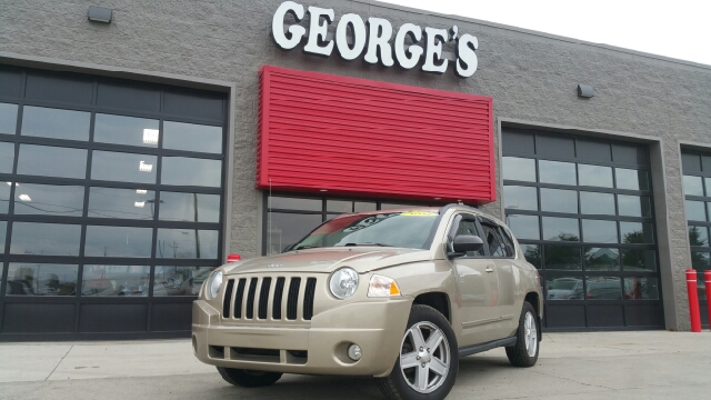 2010 JEEP COMPASS SPORT 4DR SUV light sandstone metallic seating is perfect for the lazy boy gau