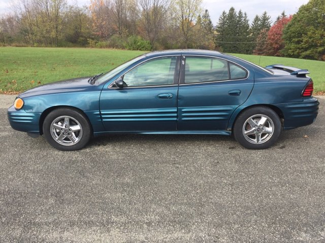 2002 pontiac grand am se1 4dr sedan in loyalhanna pa hutchys auto sales service. Black Bedroom Furniture Sets. Home Design Ideas