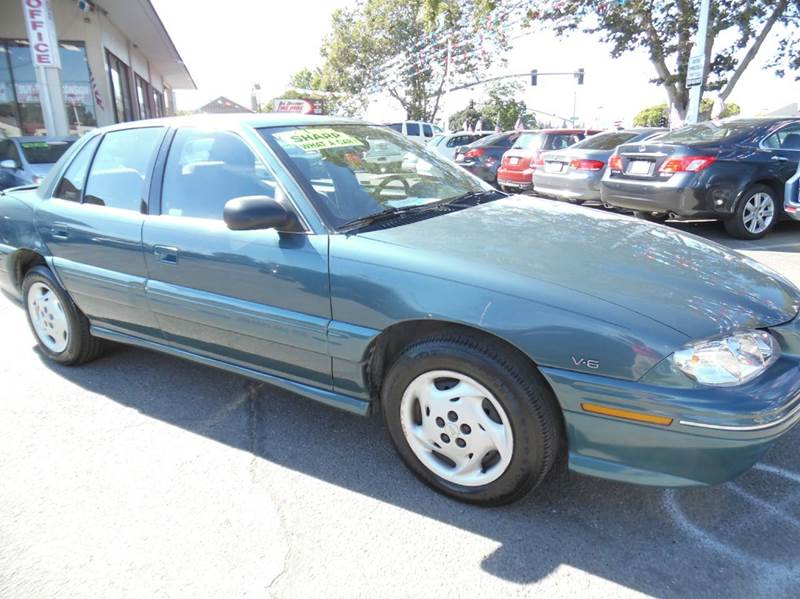 1998 PONTIAC GRAND AM SE 4DR SEDAN green need financing we can help call now  call today  cal