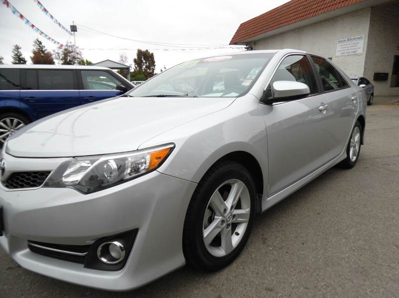 2014 TOYOTA CAMRY SE 4DR SEDAN silver certified pre-owned  need financing we can help call n