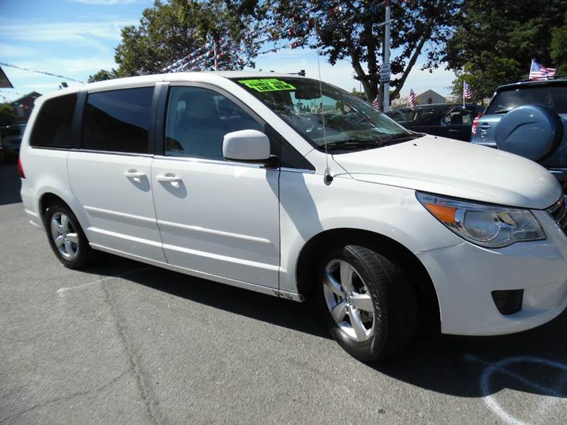 2009 VOLKSWAGEN ROUTAN SEL 4DR MINI VAN white need financing we can help call now  call today