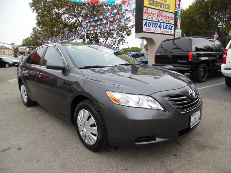 2009 TOYOTA CAMRY LE 4DR SEDAN 5A gray need financing we can help call now  call today  call