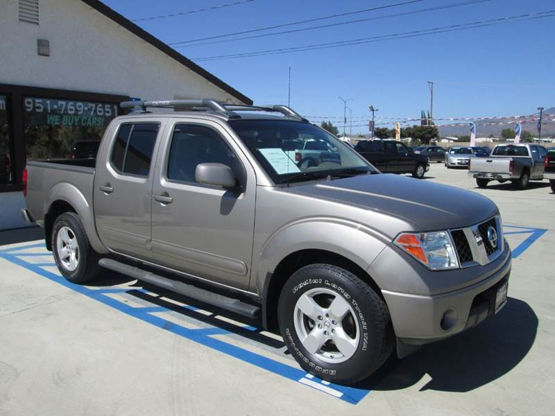 2007 nissan frontier le 4dr crew cab 5 0 ft sb in banning ca auto source. Black Bedroom Furniture Sets. Home Design Ideas
