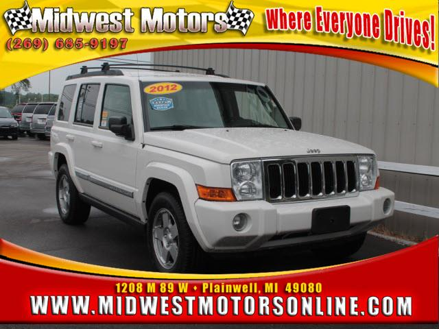 2010 JEEP COMMANDER SPORT 4X4 4DR SUV white safety comes first with anti-lock brakes parking ass