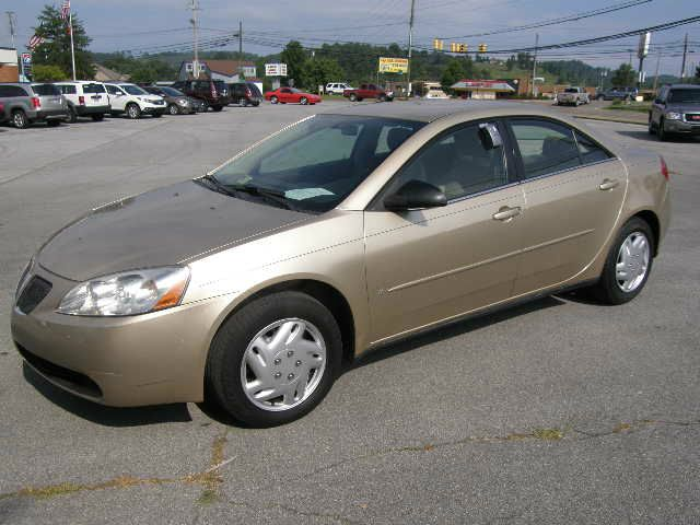 2006 PONTIAC G6 1SV SEDAN beige air conditioningamfm radioanti-brake system non-absautomatic