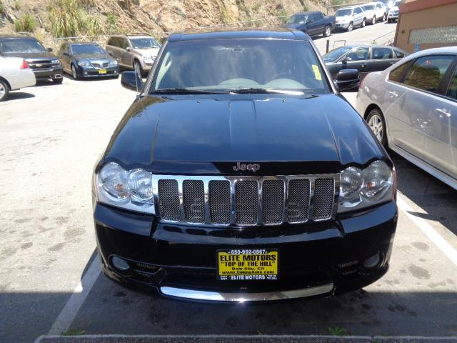 2006 JEEP GRAND CHEROKEE SRT8 4DR SUV 4WD W FRONT SIDE A black crystal 61 liter hemi navigatio