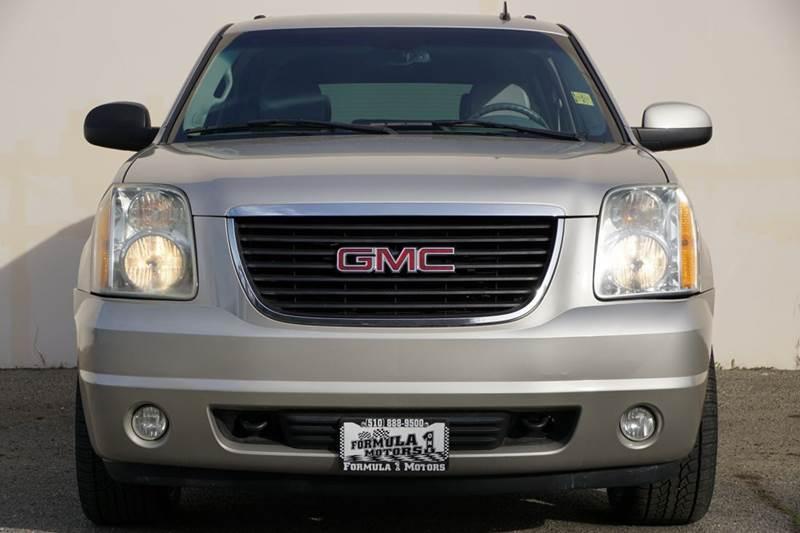 2007 GMC YUKON SLT 4DR SUV W4SA W 1 PACKAGE gold mist metallic 98473 miles VIN 1GKFC130X7R24