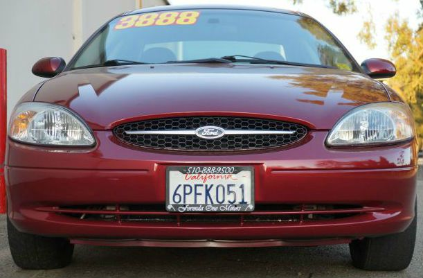 2002 FORD TAURUS SES 4DR SEDAN matador red clearcoat metallic matador red metallic clearcoat with