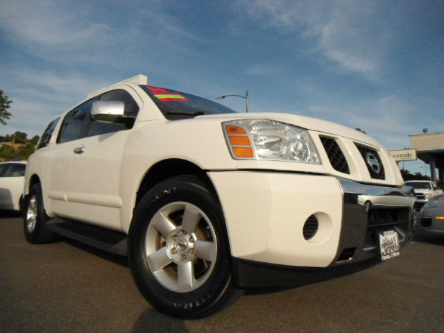 2006 NISSAN ARMADA SE 2WD white abs brakesadjustable foot pedalsair conditioningalloy wheelsam