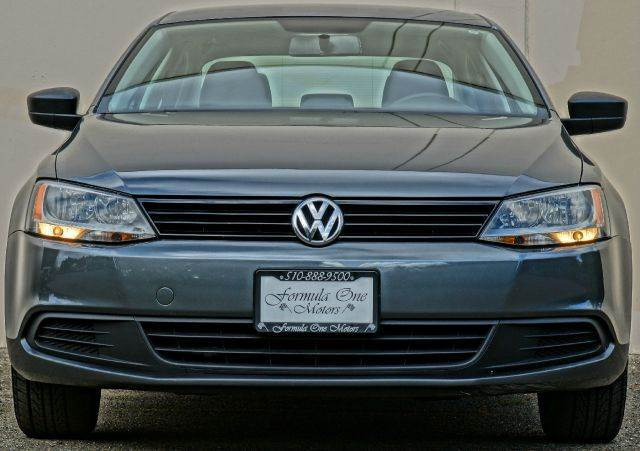 2012 VOLKSWAGEN JETTA BASE 4DR SEDAN 6A gray 2-stage unlocking - remote abs - 4-wheel airbag de