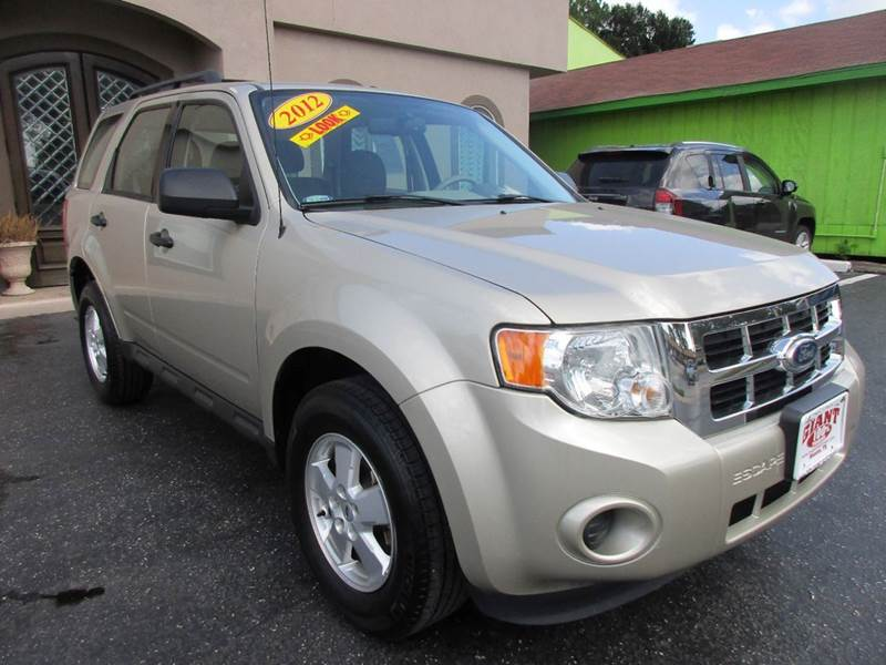 2012 FORD ESCAPE XLS 4DR SUV tan 1 owner vehicle history and an above averaged interior and exter
