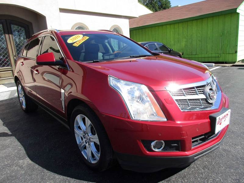2010 CADILLAC SRX PERFORMANCE COLLECTION 4DR SUV red if your looking at the srx for an suv and kno