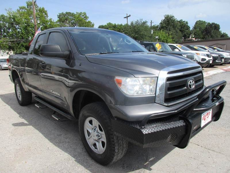 2011 TOYOTA TUNDRA GRADE 4X4 4DR DOUBLE CAB PICKUP gray nobody walks is our signature motto and