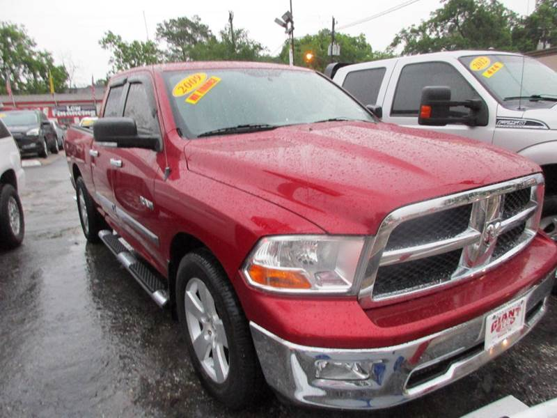 2009 DODGE RAM PICKUP 1500 SLT 4X2 4DR QUAD CAB 63 FT SB red just an excellent conditioned truck