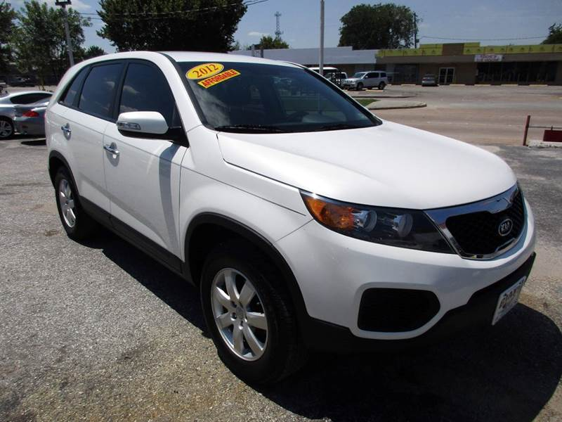 2012 KIA SORENTO LX 4DR SUV white nobody walks is our signature motto and that simply means