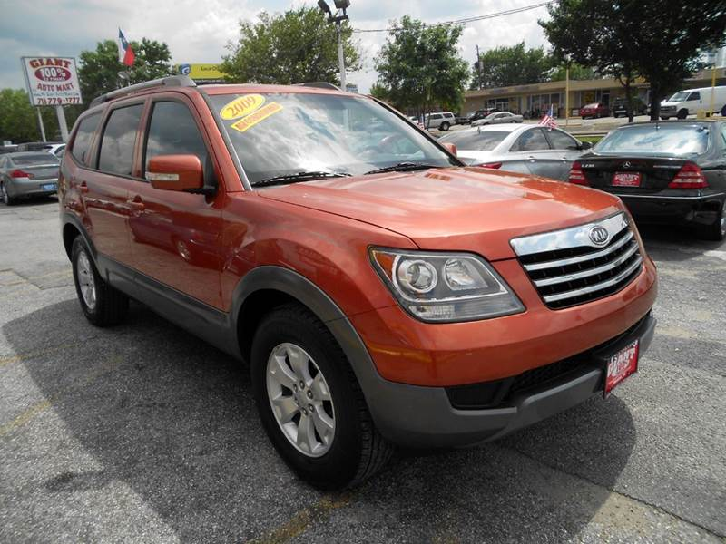 2009 KIA BORREGO LX 4DR SUV copperhead metallic thirds row seating in this attractive and very ver