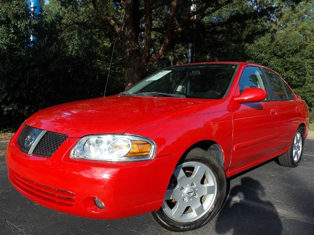 2006 NISSAN SENTRA 18 red well maintained ready to go vehicle with features like satellite radio