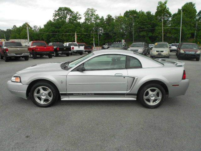 2003 FORD MUSTANG BASE 2DR COUPE silver anti-theft system - alarm center console clock front a