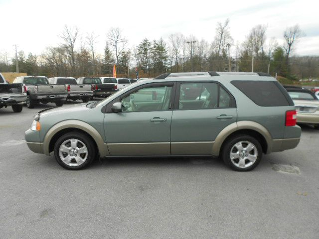 2005 FORD FREESTYLE SEL AWD 4DR WAGON green abs - 4-wheel cd changer center console - front con