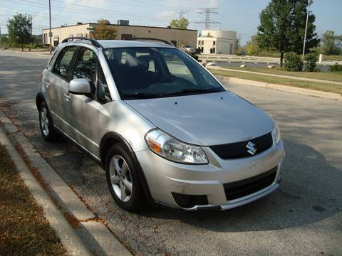 2007 Suzuki SX4 Crossover for sale at ARIANA MOTORS INC in Itasca IL