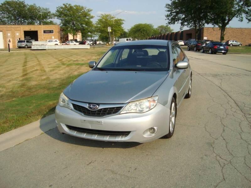 2009 Subaru Impreza for sale at ARIANA MOTORS INC in Addison IL