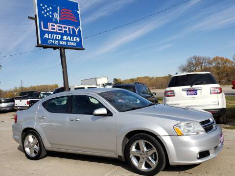 2011 Dodge Avenger for sale at Liberty Auto Sales in Merrill IA
