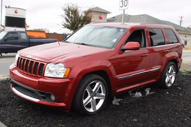 2006 JEEP GRAND CHEROKEE SRT8 4DR SUV 4WD W FRONT SIDE A red advanced multi-stage frontal airbag