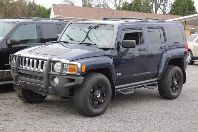 2007 HUMMER H3 4WD blue air bags frontal driver and right-front passenger with passenger sensin