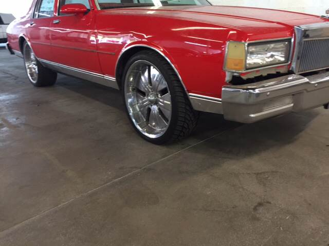 1990 CHEVROLET CAPRICE BASE 4DR STD SEDAN red if you are looking for a classic this is it nice